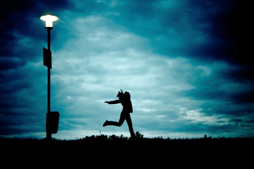 silhouette-of-young-woman-running-at-night.jpg