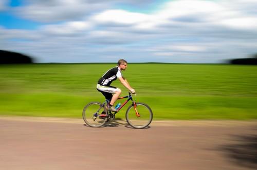 man-riding-bicycle-side-view.jpg